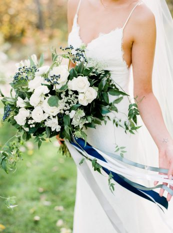 White and blue bouquet by Oak & Lily Flowers Photo by Brittany Mahood br-wedding167