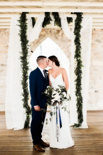 Oak & Lily Flowers Photo by Brittany Mahood br-wedding551